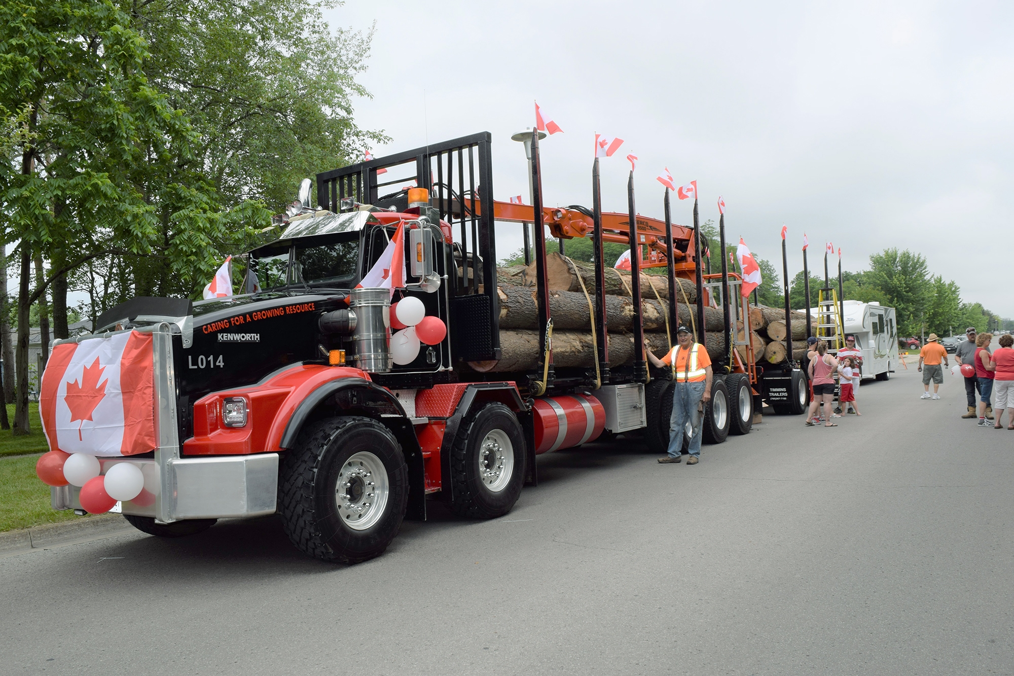 Townsend lumber truck covered in red and white balloons for Canada Day.