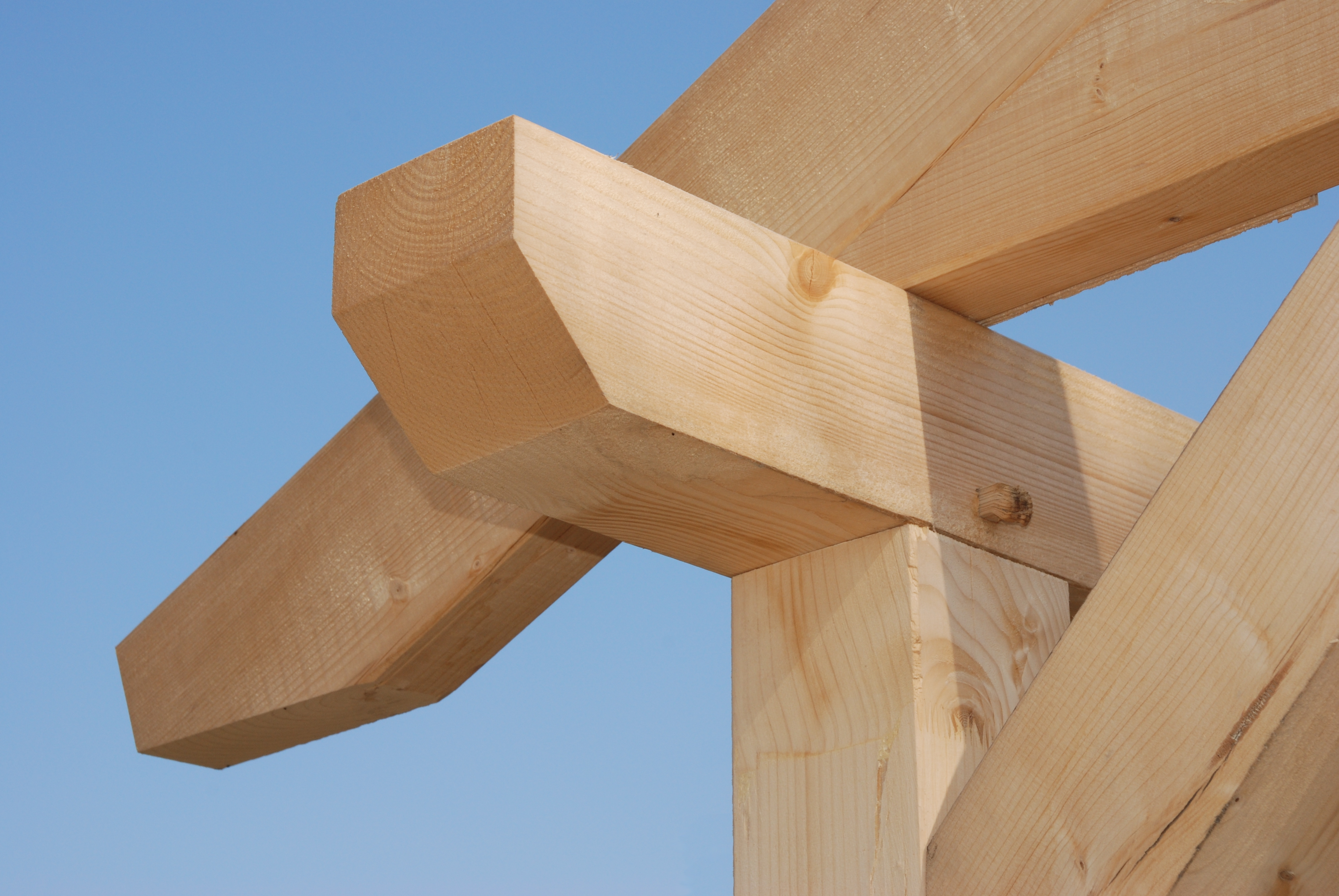 Close up of a timber frame construction for a house.